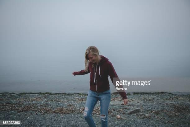 Attractive thin blonde on foggy beach
