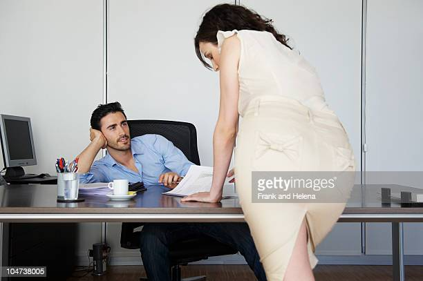 Attractive woman and male colleague