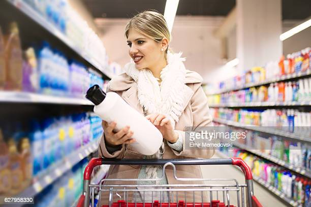 Attractive woman buying groceries in a supermarket