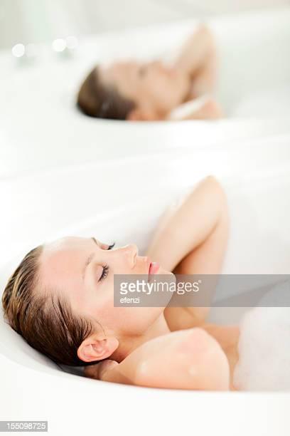 Attractive Woman Dreaming In Bathtub