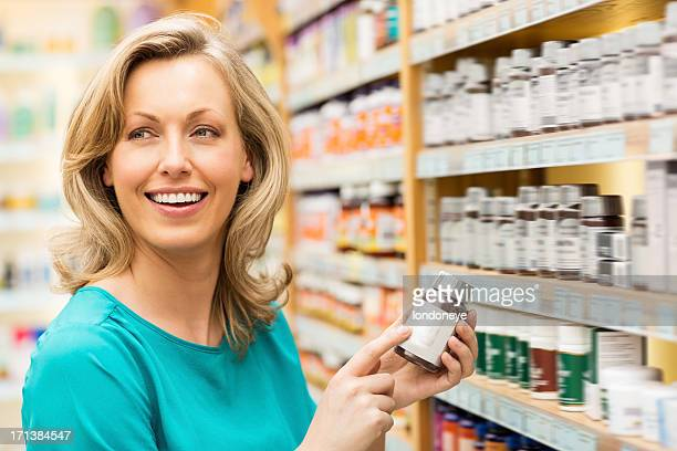 Attractive Woman Holding Pill Bottle