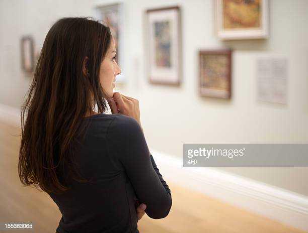 attractive woman in an art gallery (xxxl) - konstmuseum bildbanksfoton och bilder