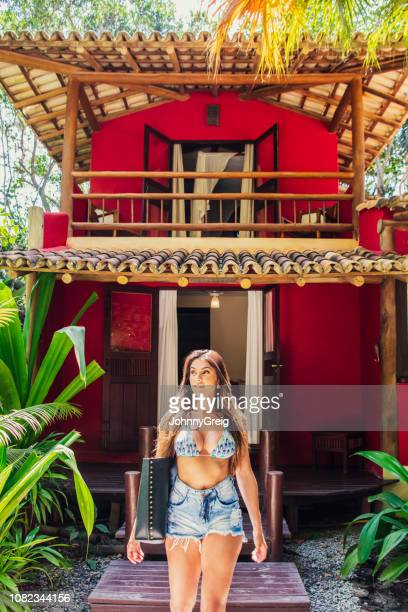 attractive woman in bikni top on vacation - hot pants stock pictures, royalty-free photos & images
