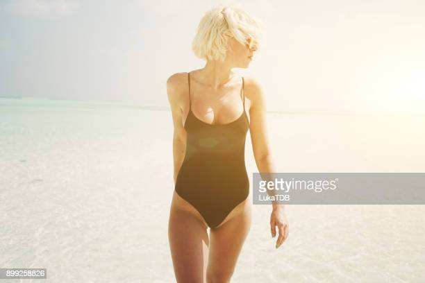 attractive woman in black swimsuit on maldives - heat wave stock pictures, royalty-free photos & images
