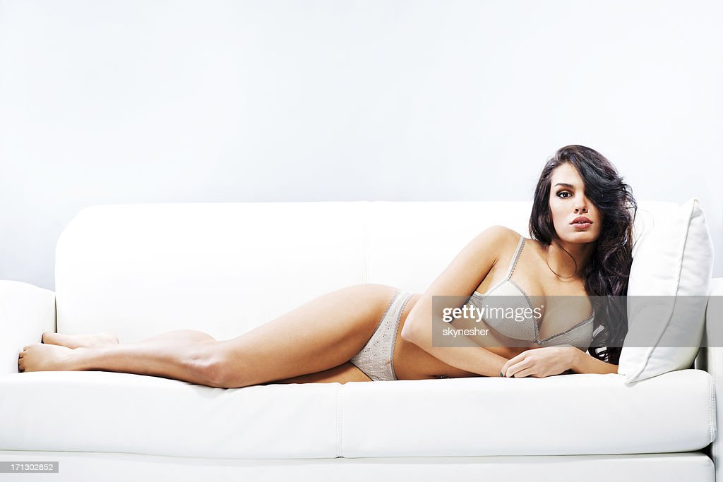 Attractive woman in underwear lying on sofa. : Stock Photo