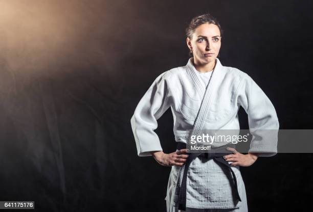 attractive woman karate instructor - judo stock photos and pictures