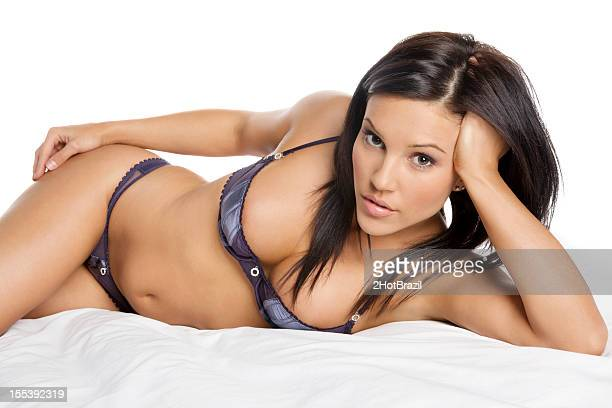 Attractive Woman Laying in a Lingerie