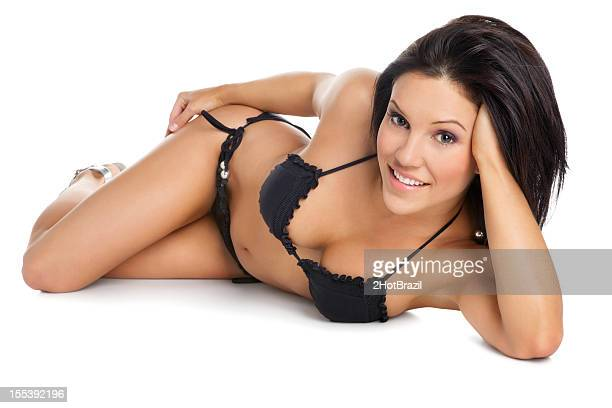 attractive woman lying in a bikini - booby stock pictures, royalty-free photos & images