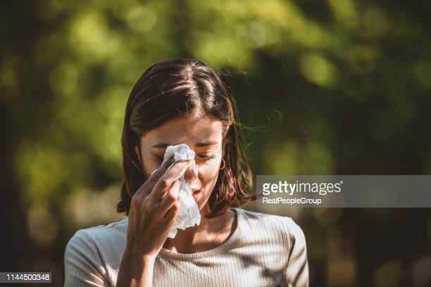 attractive woman outdoors is having allergy - allergy stock pictures, royalty-free photos & images