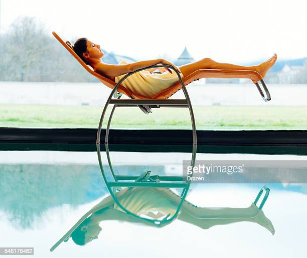 Attractive woman relaxing in spa and resting near pool