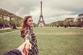 Attractive woman sightseeing Paris with her boyfriend