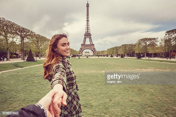 attractive woman sightseeing paris with her boyfriend - following stock pictures, royalty-free photos & images