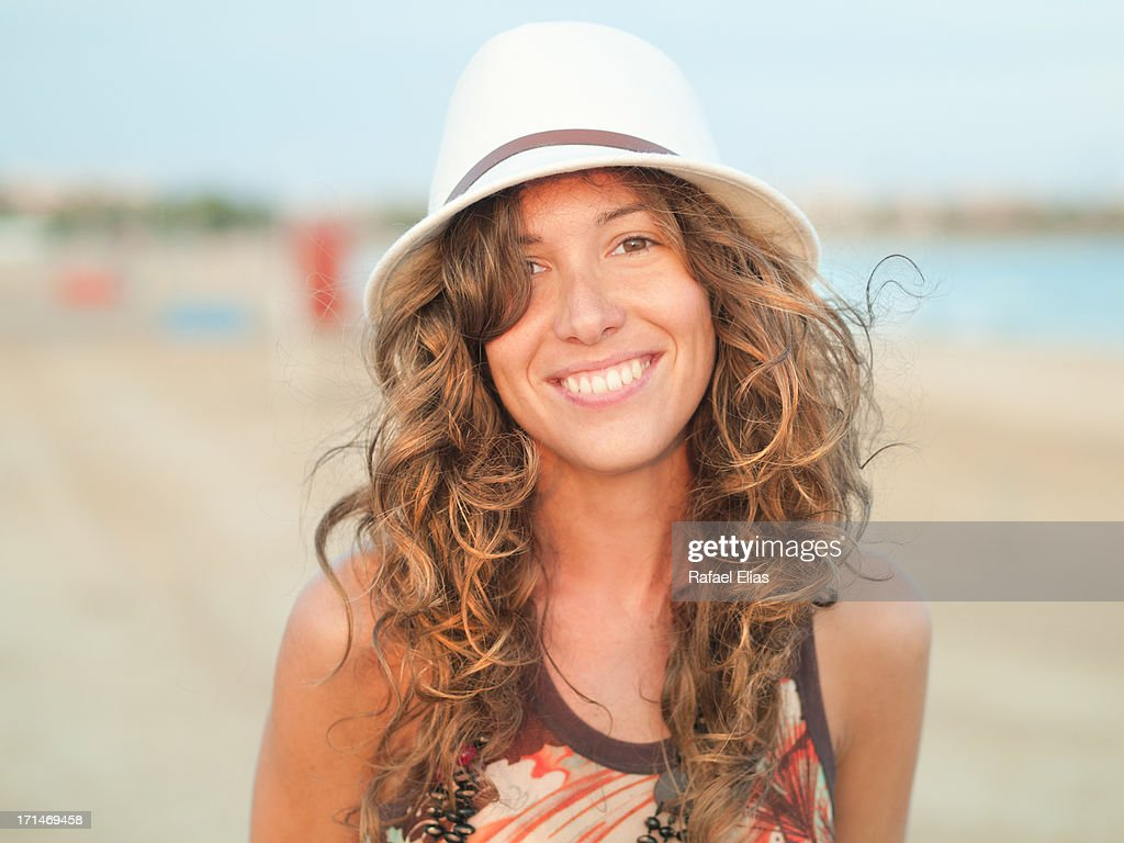 Attractive woman smiling on the beach : Stock Photo