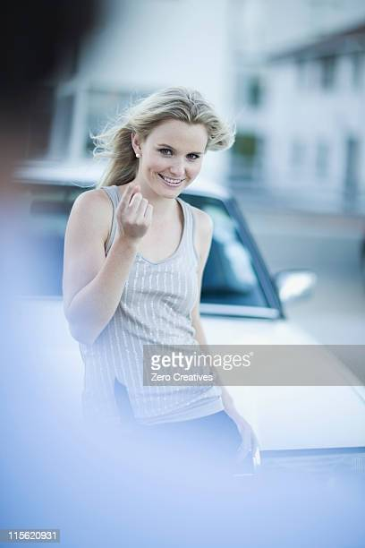 Attractive woman standing infront of car
