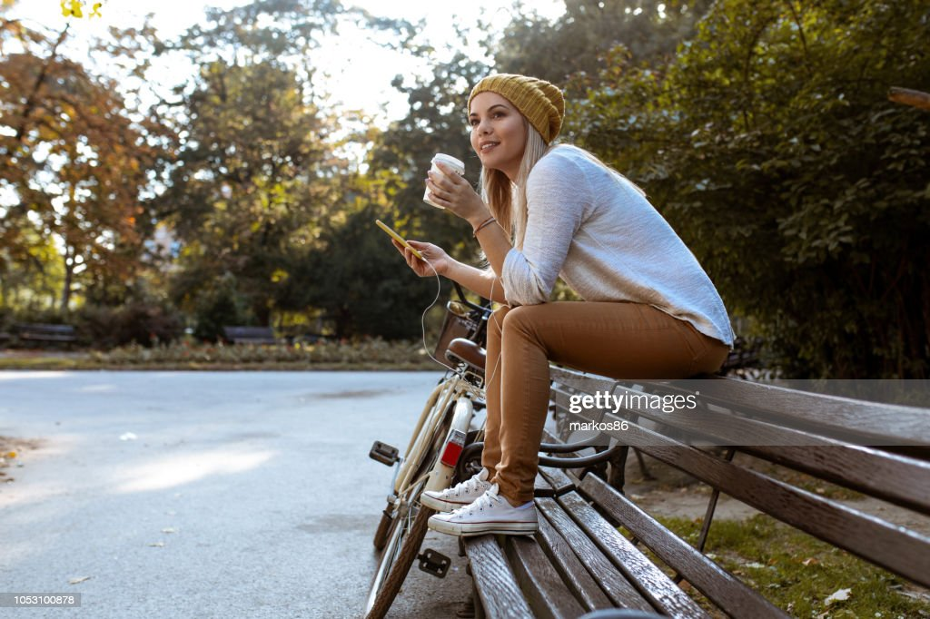 Attractive woman taking a coffee break : Stock Photo