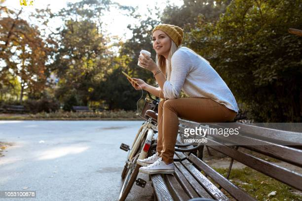 attractive woman taking a coffee break - sitting stock pictures, royalty-free photos & images