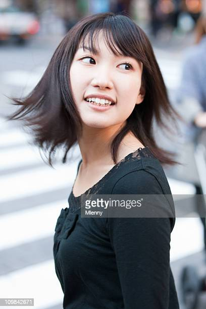 Attractive woman turning back, looking with a bright smile