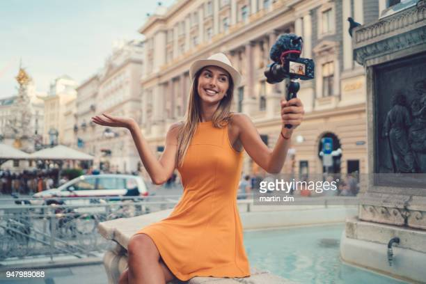 attractive woman vlogging from vienna - influencer stock pictures, royalty-free photos & images