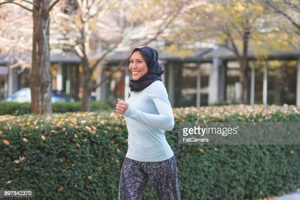 Attractive Woman Wearing Hijab Goes for a Jog