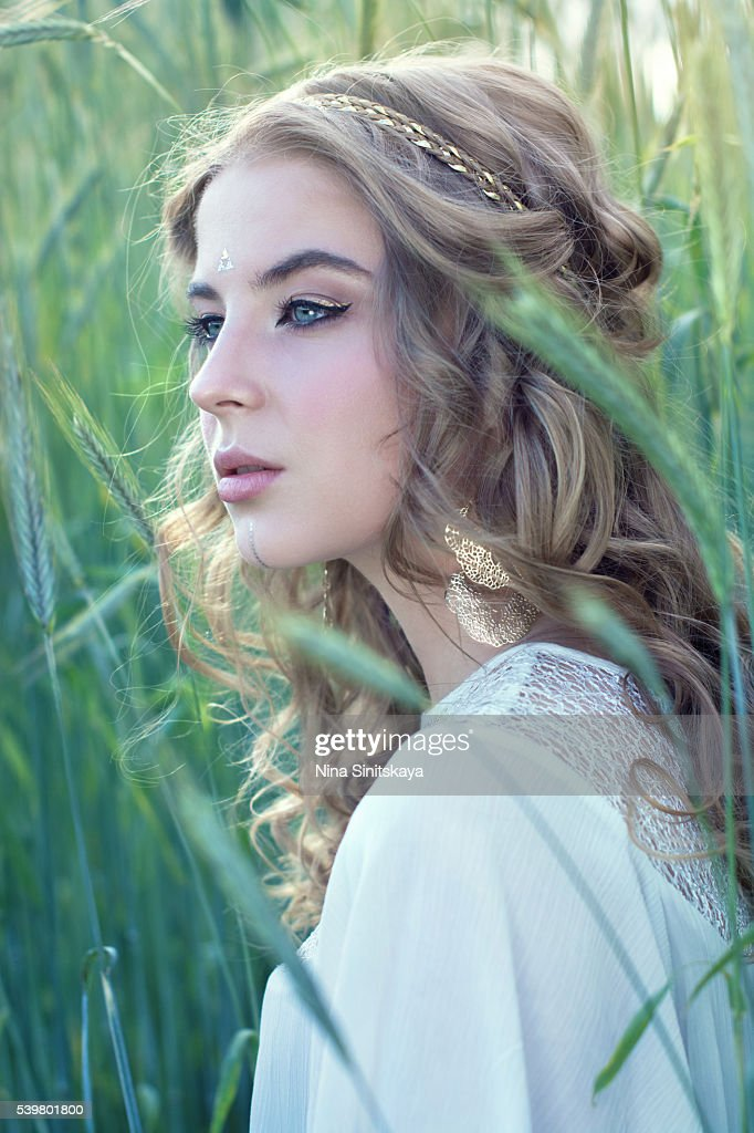 Attractive Woman With Blonde Curly Hair And Blue Eyes In Nature High Res Stock Photo Getty Images