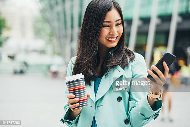 Attractive woman with phone and coffee