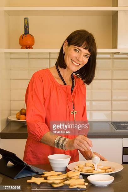 Attractive women icing biscuits