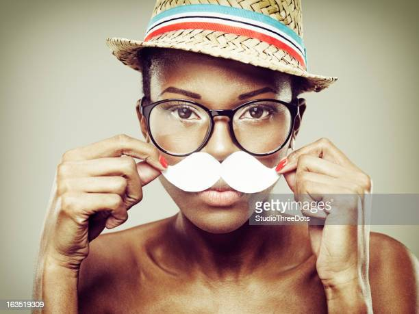 Attractive Young African Woman With Paper Moustache