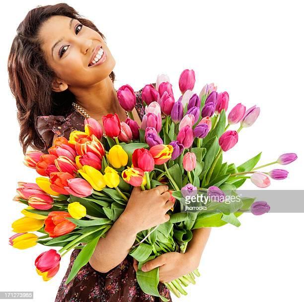 Attraktive junge asiatische Frau mit Haufen Tulpen