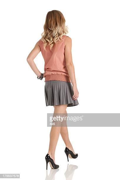 Attractive young beautiful woman walking