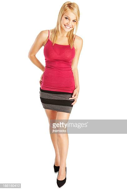 attractive young blonde woman in red camisole and gray skirt - high heels short skirts stock pictures, royalty-free photos & images