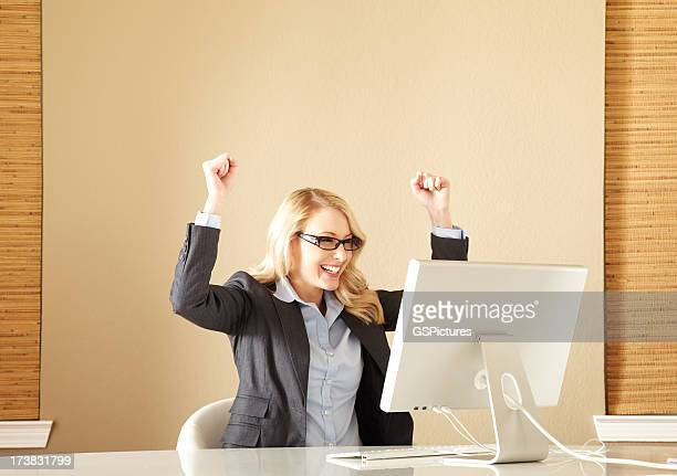 Attractive Young Businesswoman Celebrating Victory