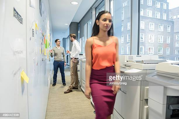 Attractive young businesswoman in modern office, blurred motion