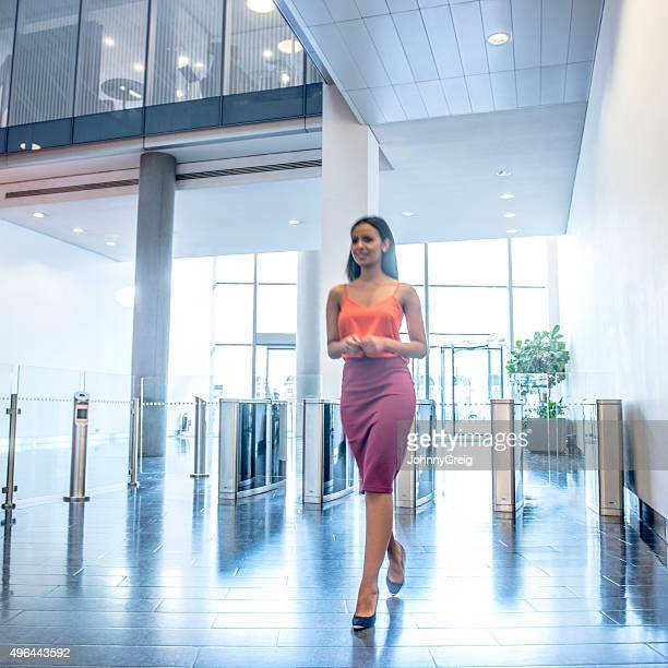 Attractive young businesswoman in modern office foyer