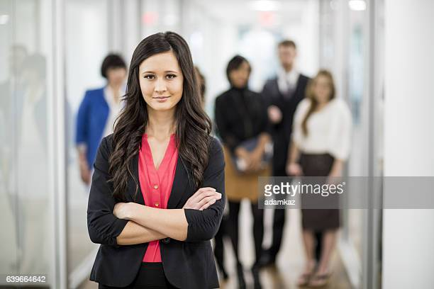 Attractive Young Businesswoman Leading Her Team