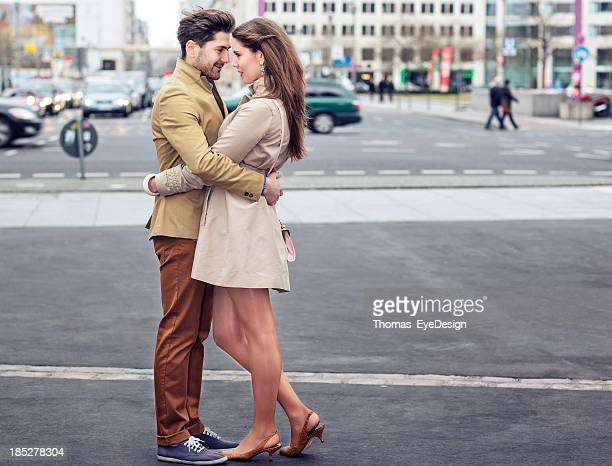 attractive young couple embracing on potsdamer platz - kissing stock pictures, royalty-free photos & images
