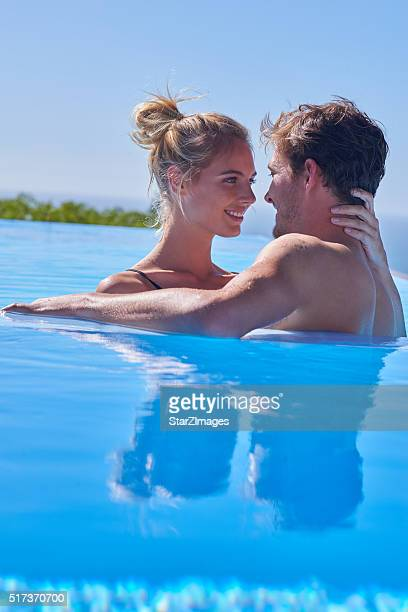 Attractive young couple relaxing in awesome pool