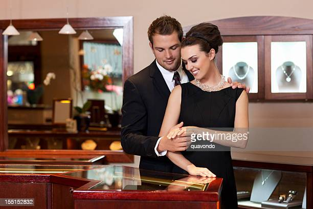 attractive young couple shopping for rings in jewelry store, copyspace - man holding engagement ring stock photos and pictures