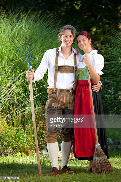 attractive young farmer couple - traditionally austrian stock pictures, royalty-free photos & images