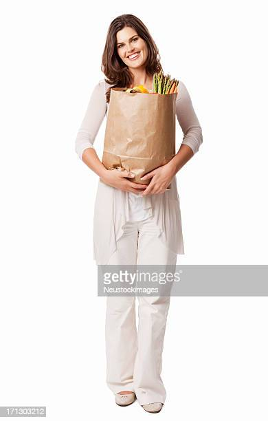 Attractive Young Female Holding a Bag Of Groceries - Isolated