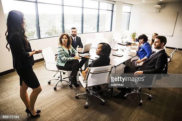 Attractive Young Female Leading A Brainstorming Meeting