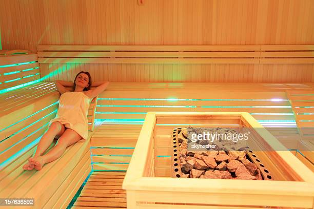 Attractive young girl spends her spare time in the sauna.