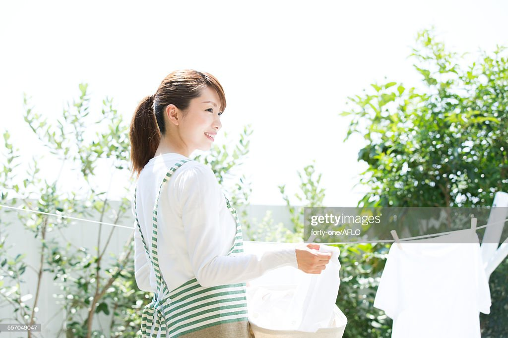 Attractive young housewife : Stock Photo
