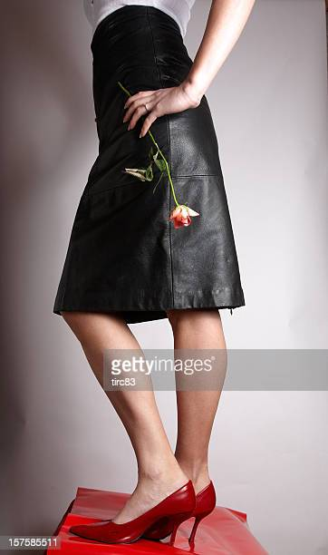 Attractive young lady black leather skirt
