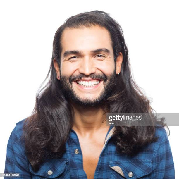 Attractive young man smiling on white