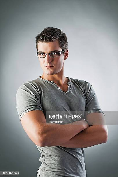 Attractive young man wearing glasses.