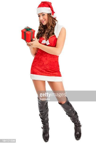 attraktive junge frau in santa mit geschenk box rot - weihnachtsfrau stock-fotos und bilder