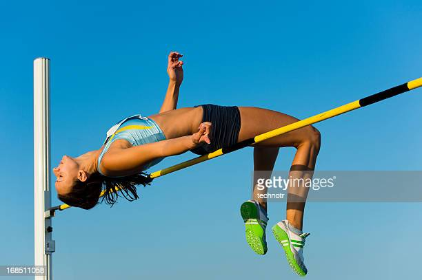 attractive young woman at high jump - high jump stock pictures, royalty-free photos & images