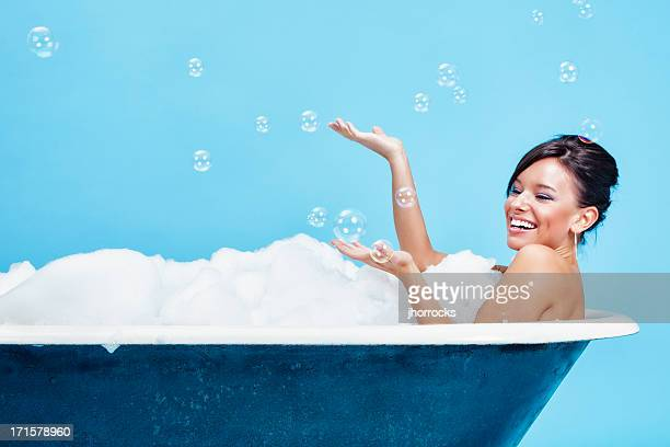Attractive Young Woman Enjoying a Bubble Bath