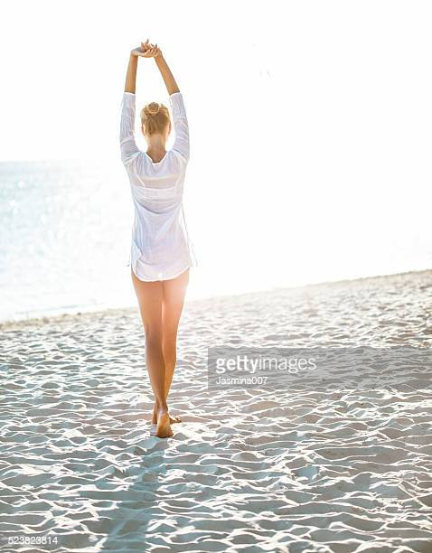 attractive young woman  enjoying a day at the beach - beach photos stock photos and pictures