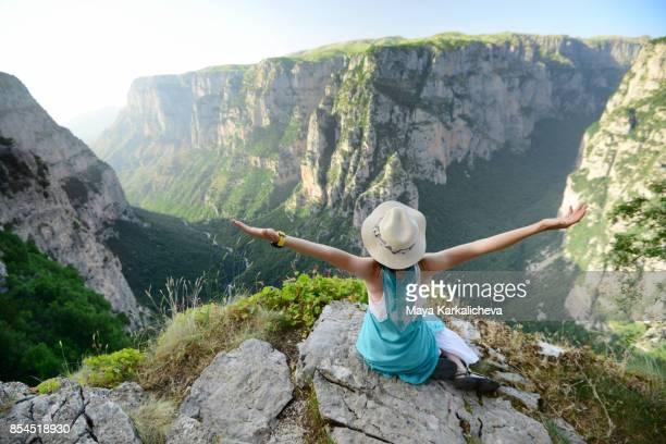 Attractive young woman enjoying a moment in a mountain, Vikos canyon, Tymfi mountain, Zagoria / Epirus, Greece